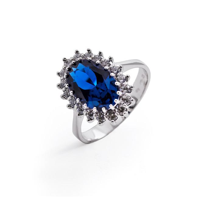 73c60781e Dámsky prsteň so syntetickým zafírom a zirkónmi - ZLATOKOV